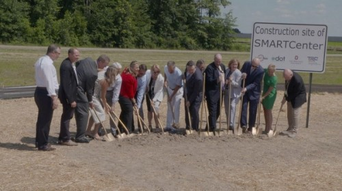 Representatives from various organizations gathered to break ground on the Transportation Research Center's new SMART Center Monday in East Liberty, Ohio.