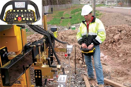 GOMACO wireless control handset is for use on three-track curb and gutter machine