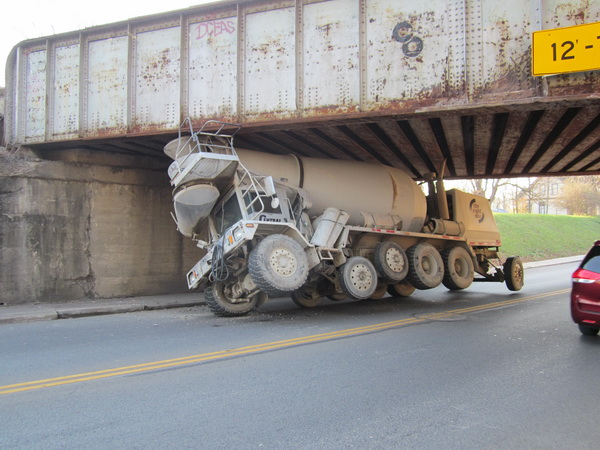Charging funnels on front-discharge mixers sit too high for this truck to make it under this 12 foot 7 inch railroad overpass