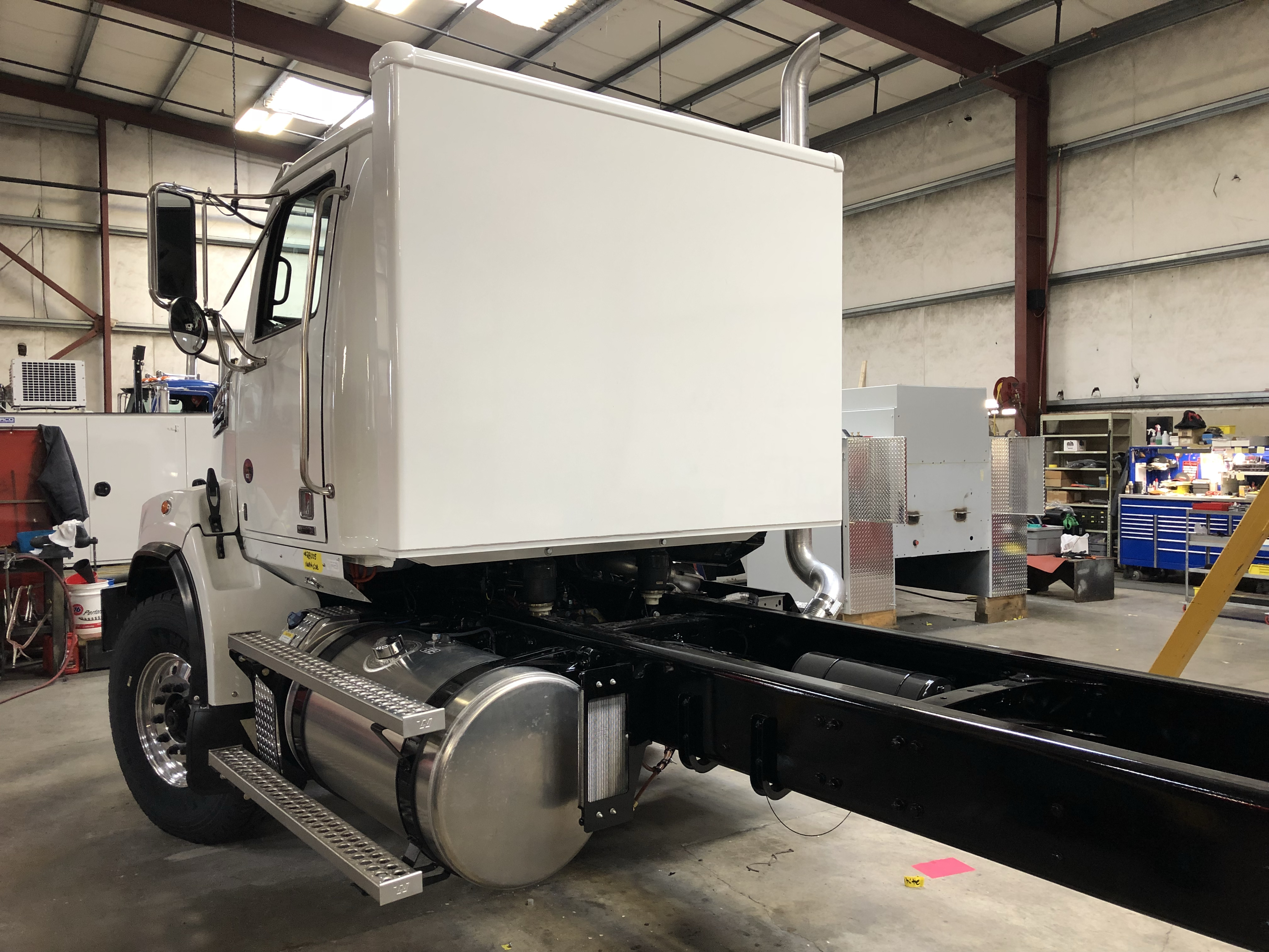 Pack packs are added to the rear of a Western Star cab and are accessed via a standard cab cutout.