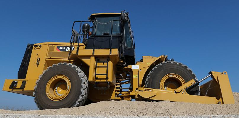 Caterpillar 248-horsepower 814K wheel dozer has an operating weight of 48,390 pounds.