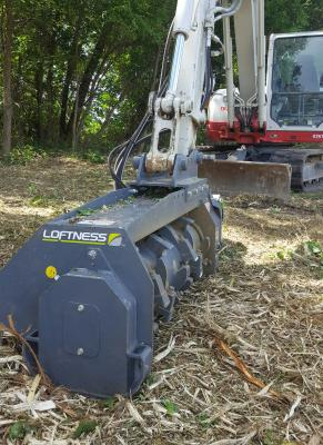 Battle Ax mulching attachment for 7- to 15-ton excavators features a new rotor, a two-stage cutting chamber, and a direct-drive variable displacement piston motor.