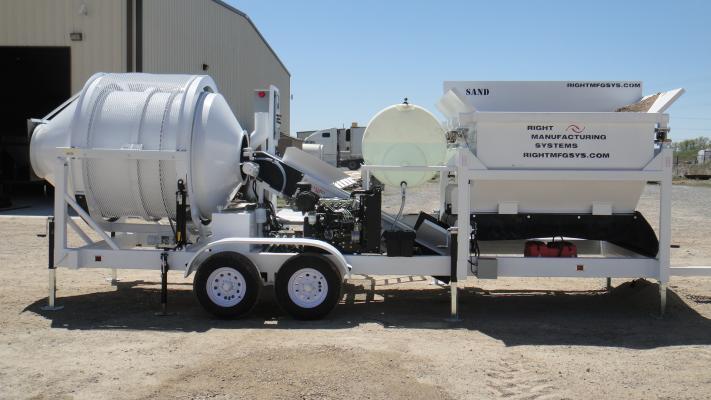 The EZ 2-8-2 portable concrete mixer and concrete batch plant mixes 2.5 cubic yards of concrete.