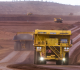 Driverless haul trucks rumble over trails at Rio Tinto's Mine of the Future in Western Australia.