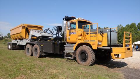 Western Star 6900XD truck-tractor has a Smithco tri-axle side-dump trailer