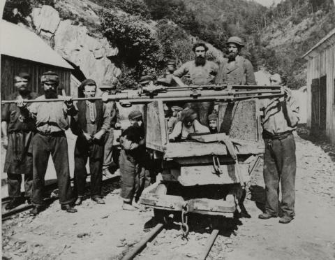 A Burleigh percussion drill on its rail-mounted carrier.