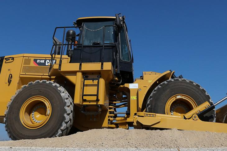 Caterpillar 248-horsepower 814K wheel dozer has an operating weight of 48,390 pounds.