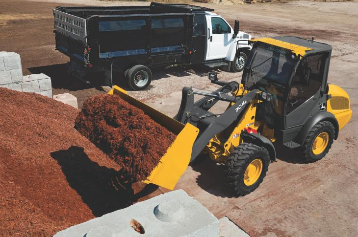 John Deere 304L compact wheel loader has a 65-horsepower Tier 4-F Yanmar engine