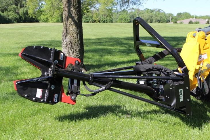 The Edge Extreme Duty High Reach Tree Clipper tree shear attachment for compact loaders features extra-long upper and lower plates to add strength to the clipper head and two extra bars on the mount for stabilization.