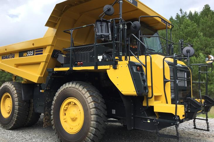 Komatsu HD325-8 rigid-frame hauler has payload capacity of 40.3 tons