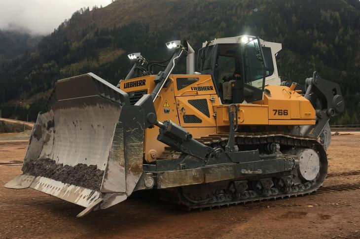 The PR 766 crawler dozer is a 422-horsepower unit with operating weights between 101,000 and 119,500 pounds, and it replaces the PR 764 in the company's line.