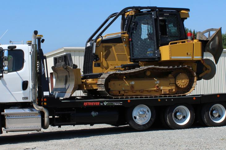 The Retriever equipment trailer allows a curved, rather than straight, load and unload approach, and its deck is lower to the ground, meaning users can complete the tie-down process while standing on the ground.